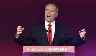 Opposition leader Bill Shorten speaks at the launch of Labor's federal election campaign at the Brisbane Convention and Exhibition Centre in Brisbane, Sunday, May 5, 2019. Australia's opposition party officially launched its election campaign putting health care and climate change at the forefront of its bid for election on May 18. (Darren England/AAP Image via AP)