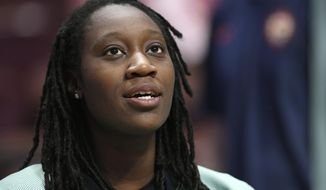 FILE - In this May 8, 2018, file photo, New York Liberty's Tina Charles attends a preseason WNBA basketball game in Uncasville, Conn. Charles has produced a documentary about her father Rawlston and his record store and label _ known as Charlie's Calypso City and Charlie's Records _ and it debuted over the weekend at the Tribeca Film Festival. (AP Photo/Jessica Hill, File)