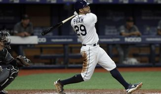 Tampa Bay Rays' Tommy Pham (29) watches his grand slam off Arizona Diamondbacks starting pitcher Merrill Kelly during the second inning of a baseball game Monday, May 6, 2019, in St. Petersburg, Fla. (AP Photo/Chris O'Meara)