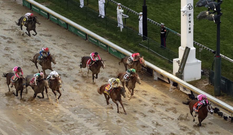Luis Saez rides Maximum Security to the finish line first against Flavien Prat on Country House during the 145th running of the Kentucky Derby horse race at Churchill Downs Saturday, May 4, 2019, in Louisville, Ky. Country House was declared the winner after Maximum Security was disqualified following a review by race stewards. (AP Photo/Charlie Riedel) **FILE**