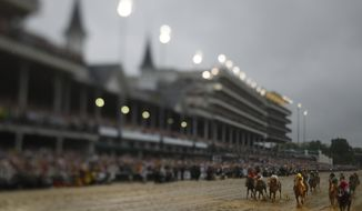 In this photo made with a tilt shift lens, Luis Saez rides Maximum Security across the finish line first during the 145th running of the Kentucky Derby horse race at Churchill Downs Saturday, May 4, 2019, in Louisville, Ky. Country House was declared the winner after Maximum Security was disqualified following a review by race stewards. (AP Photo/Matt Slocum)