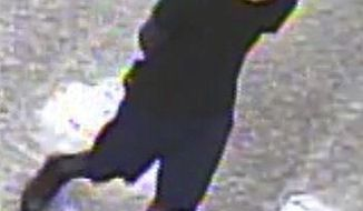 In this May 2019 security camera image released by the Mississippi Bureau of Investigations, a suspect in the death of a Biloxi police officer is seen. Authorities say the man walked up to the Biloxi officer in the station's parking lot Sunday night, May 5 shot him multiple times and then ran off. (Mississippi Bureau of Investigations via AP)