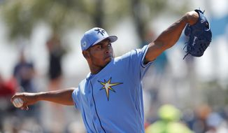 FILE - In this March 22, 2019, file photo, Tampa Bay Rays pitcher Wilmer Font works in the first inning of a spring training baseball game against the Pittsburgh Pirates in Port Charlotte, Fla. The Mets obtained right-hander Font from the Rays for a player to be named or cash Monday, May 6, 2019. (AP Photo/John Bazemore, File)