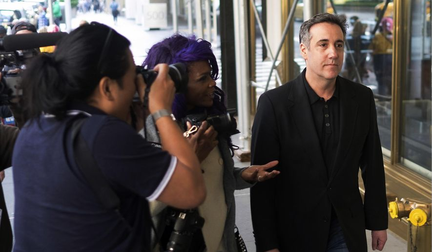 In this Saturday, May 4, 2019, file photo, Michael Cohen, President Donald Trump's former personal attorney, is confronted by members of the media as he heads back to his Park Avenue apartment in New York. (AP Photo/Jonathan Carroll, File)