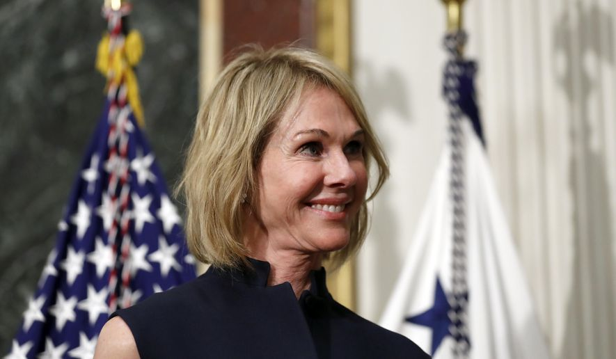 In this Sept. 26, 2017, file photo, U.S. Ambassador to Canada Kelly Knight Craft stands during her swearing in ceremony in the Indian Treaty Room in the Eisenhower Executive Office Building on the White House grounds in Washington. Ms. Craft, nominated by President Trump to be ambassador to the UN, is coming under heightened scrutiny by Democrats on the Seneate Foreign Relations Committee, who question her qualifications, credibility and alleged conflicts of interest.  (AP Photo/Alex Brandon, File) **FILE**