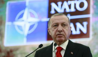"""Turkey's President Recep Tayyip Erdogan addresses a meeting of the NATO's Mediterranean Dialogue, in Ankara, Turkey, Monday, May 6, 2019. Erdogan says Turkey's decision to purchase Russian-made S-400 missile defense systems does not mean that it is seeking """"alternatives"""" in its relations with the West.(Presidential Press Service via AP, Pool)"""