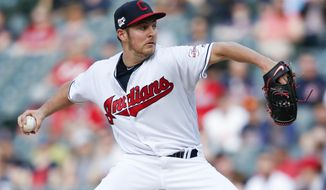 Cleveland Indians starting pitcher Trevor Bauer delivers against the Chicago White Sox during the first inning of a baseball game, Monday, May 6, 2019, in Cleveland. (AP Photo/Ron Schwane)