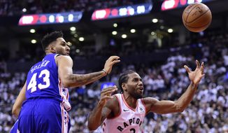 Toronto Raptors forward Kawhi Leonard (2) and Philadelphia 76ers forward Jonah Bolden (43) look for the ball during the second half of Game 5 of an NBA basketball second-round playoff series, Tuesday, May 7, 2019, in Toronto. (Frank Gunn/The Canadian Press via AP)