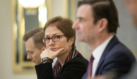 U.S. Ambassador to Ukraine Marie Yovanovitch, center, sits during her meeting with Ukrainian President Petro Poroshenko in Kiev, Ukraine, Wednesday, March 6, 2019. Yovanovitch directed unusually scathing criticism at the Ukrainian government in remarks released Wednesday, urging authorities to replace a senior anti-corruption official and tackle the country's corruption problem. (Mikhail Palinchak, Presidential Press Service Pool Photo via AP) **FILE**