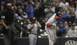 CORRECTS SPELLING TO BUCKNOR, INSTEAD OF BUCKNORN - Washington Nationals' Anthony Rendon argues with home plate umpire CB Bucknor before being ejected during the seventh inning of a baseball game against the Milwaukee Brewers Tuesday, May 7, 2019, in Milwaukee. (AP Photo/Morry Gash)