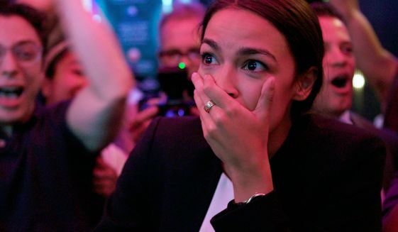 Rep. Alexandria Ocasio-Cortez took to social media to express confusion about a garbage disposal and amazement at plants in her community garden plot. (Associated Press)