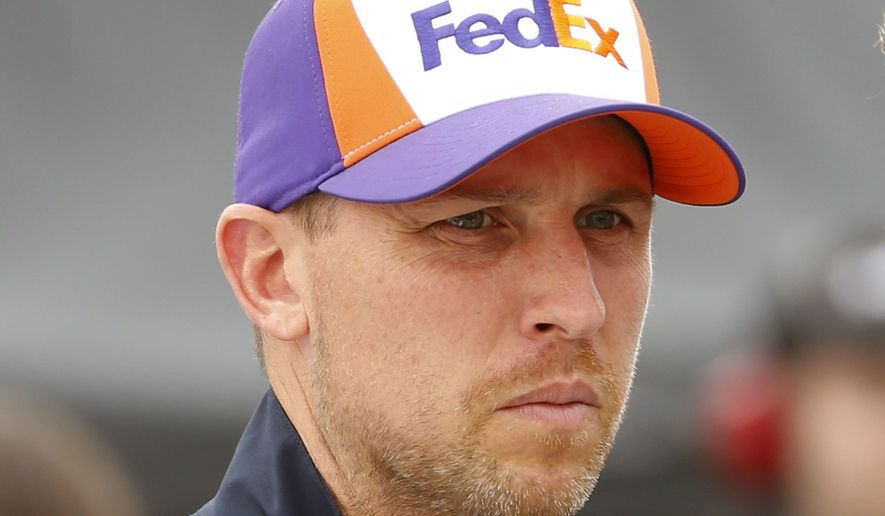 FILE - In this April 12, 2019, file photo, Denny Hamlin is shown prior to qualifying at Richmond International Raceway in Richmond, Va. Denny Hamlin suffered from nausea and double vision from carbon monoxide that seeped into his Toyota at the end of a NASCAR race at Dover, Del. Hamlin felt ill after Monday's, May 6, 2019, race and was attended to by medical staff on pit road after he finished 21st (AP Photo/Steve Helber, File) **FILE**