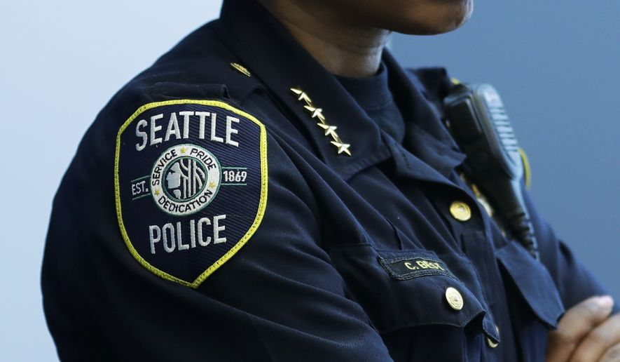 Seattle Police Chief Carmen Best listens to speakers at a news conference, Tuesday, May 7, 2019, in Seattle. (AP Photo/Ted S. Warren) ** FILE **