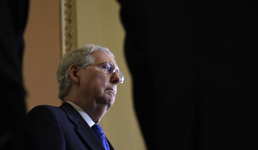 Senate Majority Leader Mitch McConnell of Ky., listens as his colleagues speak to reporters following the weekly policy lunches on Capitol Hill in Washington, Tuesday, May 7, 2019. (AP Photo/Susan Walsh)