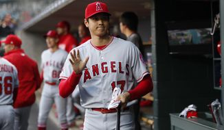 Los Angeles Angels' Shohei Ohtani waves before the team's baseball game against the Detroit Tigers in Detroit, Tuesday, May 7, 2019. (AP Photo/Paul Sancya)