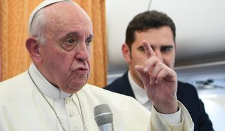 Pope Francis talks to reporters on his flight back to Rome, Tuesday, May 7, 2019. Francis made the first-ever papal visit to North Macedonia on Tuesday and sought to encourage its efforts to integrate into European institutions after its name change resolved a decades-long dispute with Greece. (Maurizio Brambatti/Pool Photo via AP)