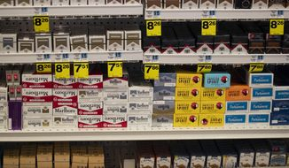 Cigarettes are displayed on store shelves Tuesday, May 7, 2019, in Beverly Hills, Calif. Beverly Hills is considering outlawing the sale of tobacco products, a move that would make the glamorous California city the first in the nation to enact such a ban. (AP Photo/Jae C. Hong)