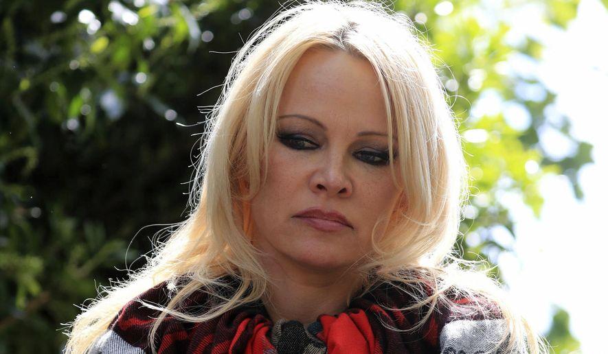 Actress Pamela Anderson speaks to the media outside Belmarsh Prison in southeast London after visiting WikiLeaks founder Julian Assange on Tuesday, May 7, 2019. (Gareth Fuller/PA via AP) **FILE**
