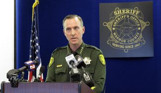 Washoe County Sheriff Darin Balaam speaks at a news conference in Reno, Nev., on Tuesday, May 7, 2019, announcing he has closed a 37-year-old murder investigation at Lake Tahoe after new DNA evidence determined the woman whose body was found near a hiking trail in 1982 was killed by a man who committed suicide in jail a year later after confessing to three other murders in California. (AP Photo/Scott Sonner)