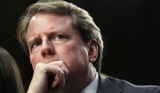 FILE - In this Sept. 4, 2018 file photo, White House counsel Don McGahn, listens as he attends a confirmation hearing for Supreme Court nominee Brett Kavanaugh before the Senate Judiciary Committee on Capitol Hill in Washington.  (AP Photo/Jacquelyn Martin)