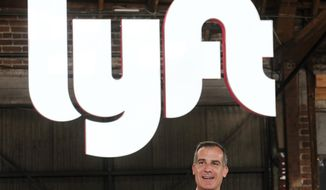 FILE - In this March 29, 2019 file photo, Los Angeles mayor Eric Garcetti speaks during and event for Lyft in Los Angeles. Lyft reports financial results on Tuesday, May 7, 2019. (AP Photo/Ringo H.W. Chiu, File)