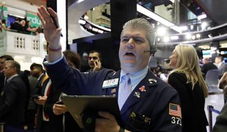 In this April 11, 2019, file photo trader John Panin works on the floor of the New York Stock Exchange. (AP Photo/Richard Drew, File)