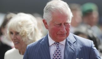 Britain's Prince Charles, the Prince of Wales and his wife Camilla, Duchess of Cornwall, arrive for a four days visit in Germany, at the airport Tegel in Berlin, Germany, Tuesday, May 7, 2019. (AP Photo/Markus Schreiber, Pool)