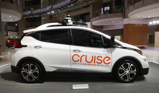 FILE - In this Jan. 16, 2019, file photo, Cruise AV, General Motor's autonomous electric Bolt EV is displayed in Detroit. A group of institutional investors is sinking $1.15 billion into GM Cruise LLC, the autonomous vehicle unit of General Motors. GM announced the investment from a group led by T. Rowe Price on Tuesday, May 7, and said it included money from GM, Honda and Japanese tech investment firm SoftBank. (AP Photo/Paul Sancya, File)