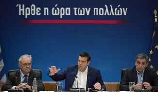Greek Prime Minister Alexis Tsipras, center, announces bailout relief measures next to the Greek Financial Minister Euklid Tsakalotos, right, and the Deputy Prime Minister Yannis Dragasakis, during a press conference, in Athens, on Tuesday, May 7, 2019. Greece's left-wing prime minister has promised crisis-weary voters a series of tax-relief measures ahead of elections, after outperforming budget targets set by bailout creditors. (AP Photo/Petros Giannakouris)