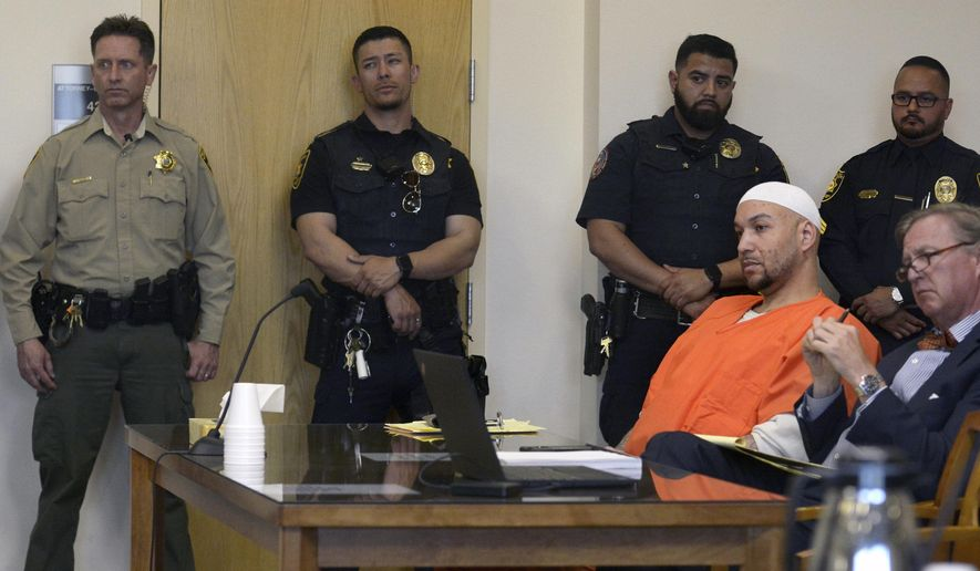 Davon Lymon listens during his sentencing hearing for the murder of Albuquerque Police Officer Daniel Webster, Tuesday, May 7, 2019 in Albuquerque, N.M.. Lymon, a felon convicted of killing an Albuquerque police officer during a 2015 traffic stop will spend the rest of his life in prison after being told by a state district judge Tuesday that he has shown no remorse for his actions. (Greg Sorber/The Albuquerque Journal via AP)