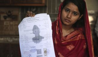 In this April 14, 2019, file photo, Mahek Liaqat, who married a Chinese national, shows her marriage certificate in Gujranwala, Pakistan. Poor Pakistani Christian girls are being lured into marriages with Chinese men, whom they are told are Christian and wealthy only to end up trapped in China, married to men who are neither Christian nor well-to-do, and some are unable to return home. (AP Photo/K.M. Chaudary)