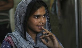 In this April 14, 2019 photo, Muqadas Ashraf speaks to The Associated Press in Gujranwala, Pakistan. Muqadas Ashraf was just 16 when her parents married her off to a Chinese man who had come to Pakistan looking for a bride. Less than five months later, Muqadas is back home in Pakistan, pregnant and seeking a divorce from a husband she says was abusive. (AP Photo/K.M. Chaudary)