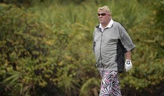 In this Dec. 15, 2018, file photo John Daly walks on the ninth green during the first round of the Father Son Challenge golf tournament in Orlando, Fla. The PGA Championship is allowing Daly to use a cart next week at Bethpage Black. It will be the first time since Casey Martin in the U.S. Open in 2012 that a player is allowed to ride a cart during a major. (AP Photo/Phelan M. Ebenhack, File) **FILE**