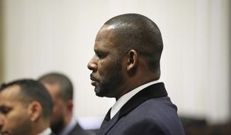 R. Kelly stands during a hearing in his sex abuse case at Leighton Criminal Court Building Tuesday, May 7, 2019 in Chicago. (E. Jason Wambsgans/Chicago Tribune via AP, Pool)