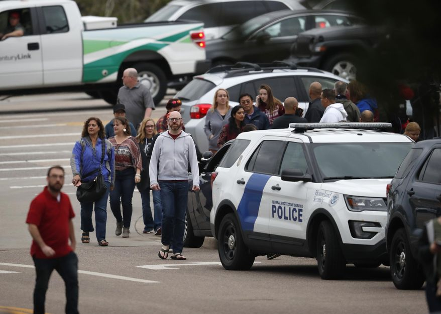 Parents head into a recreation center for students to get reunited with their parents after a shooting Tuesday, May 7, 2019, in Highlands Ranch, Colo. (AP Photo/David Zalubowski)