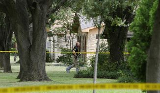 """FILE - In this Sept. 12, 2017, file photo, police investigate at the scene of a shooting on West Spring Creek Parkway in Plano, Texas. Authorities have arrested a bartender who served drinks to a man who later went to his estranged wife's home and fatally shot her and seven others as they gathered to watch the Dallas Cowboys play. Lindsey Glass was arrested last week and charged with a misdemeanor violation of """"sale to certain persons."""" The law prohibits the sale of alcohol to a """"habitual drunkard or an intoxicated or insane person."""" Authorities say 32-year-old Hight in September 2017 already showed signs of intoxication at the Plano bar before leaving for the home of Meredith Hight and opening fire. (Vernon Bryant/The Dallas Morning News via AP, File)"""