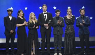 """FILE - In this Jan. 13, 2019, file photo, Kunal Nayyar, from left, Mayim Bialik, Melissa Rauch, Jim Parsons, Simon Helberg, Kaley Cuoco and Johnny Galecki, from the cast of """"The Big Bang Theory,"""" present the creative achievement award at the 24th annual Critics' Choice Awards at the Barker Hangar in Santa Monica, Calif. Hugs and tears punctuated the final taping of """"The Big Bang Theory,"""" a lovefest for its stars, crew and audience alike. There were plenty of punchlines as well, as the true-to-form hit comedy about scientists and those who love them wrapped the two-part, hour-long finale that will air in mid-May on CBS. (Photo by Chris Pizzello/Invision/AP, File)"""