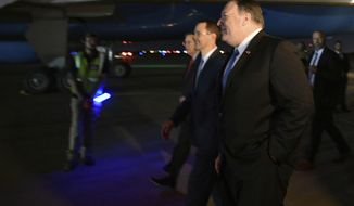 U.S. Secretary of State Mike Pompeo, right, walks with Acting Assistant Secretary for Near Eastern Affairs at the State Department David Satterfield and Charge D'affaires at the U.S. Embassy in Baghdad Joey Hood, second from right, after arrivng in Baghdad for meetings Tuesday, May 7, 2019. (Mandel Ngan/Pool Photo via AP)