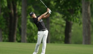 Sangmoon Bae, of South Korea, watches his shot on the 16th hole during the first round of the Wells Fargo Championship golf tournament at Quail Hollow Club in Charlotte, N.C., Thursday, May 2, 2019. (AP Photo/Jason E. Miczek)