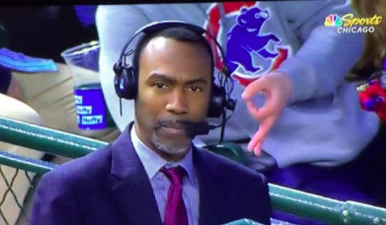 "A Chicago Cubs fan makes the ""OK"" sign during a May 7, 2019, game at Wrigley Field. The organization aid it is investigating the ""hand gesture that is associated with racism."" (Image: NBC Sports Chicago screenshot)"