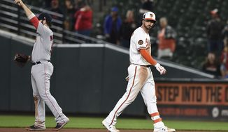 Baltimore Orioles' Trey Mancini, right, walks to the dugout after being robbed of a home run by Boston Red Sox center fielder Jackie Bradley Jr. during the 11th inning of a baseball game Wednesday, May 8, 2019, in Baltimore. The Red Sox won 2-1 in 12 innings. (AP Photo/Gail Burton) ** FILE **
