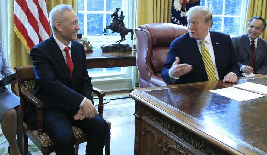 In this April 4, 2019, file photo, President Donald Trump meets China's Vice Premier Liu He in the Oval Office of the White House in Washington. (AP Photo/Manuel Balce Ceneta, File)