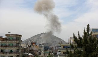 Smokes rises after a huge explosion near the offices of the attorney general in Kabul, Afghanistan, Wednesday, May 8, 2019. Two police officials say Wednesday's explosion was followed by a gunbattle between militants and security forces. (AP Photo/Rahmat Gul)