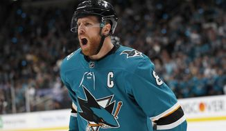 San Jose Sharks center Joe Pavelski (8) celebrates after scoring a goal against the Colorado Avalanche during the first period of Game 7 of an NHL hockey second-round playoff series in San Jose, Calif., Wednesday, May 8, 2019. (AP Photo/Josie Lepe) ** FILE **
