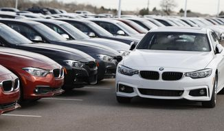 FILE - This Jan. 13, 2019, file photo shows a lineup of 3 Series sedans at a BMW dealership in Highlands Ranch, Colo. BMW offers free maintenance but the duration in 2019 isn't as generous as it used to be. (AP Photo/David Zalubowski, File)