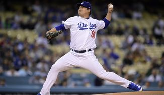 Los Angeles Dodgers starting pitcher Hyun-Jin Ryu, of South Korea, throws to the plate during the first inning of a baseball game against the Atlanta Braves, Tuesday, May 7, 2019, in Los Angeles. (AP Photo/Mark J. Terrill)