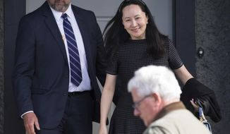 Huawei Chief Financial Officer Meng Wanzhou, back right, who is out on bail and remains under partial house arrest after she was detained Dec. 1 at the behest of American authorities, is accompanied by a private security detail as she leaves her home to attend a court appearance in Vancouver, British Columbia, Wednesday, May 8, 2019. (Darryl Dyck/The Canadian Press via AP)
