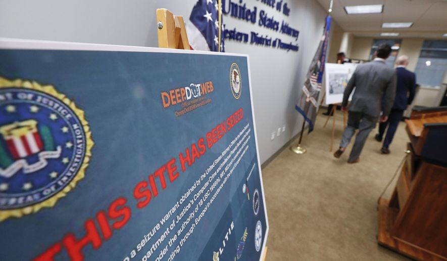 A poster showing the seized website screen of Deep.Dot.Web is displayed as law enforcement officials leave a news conference about the shutting down of the website and the arrest of the people running it, Wednesday, May 8, 2019, in Pittsburgh. The investigation was led by the United States Attorney's Office in Western Pennsylvania and the Federal Bureau of Investigation. (AP Photo/Keith Srakocic) **FILE**