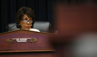 In this April 10, 2019, photo, House Financial Services Committee chairwoman Maxine Waters, D-Calif., listens during a hearing with leaders of major banks on Capitol Hill in Washington. After nearly three decades in Waters has become the highest-ranking African American woman in the country. (AP Photo/Patrick Semansky) **FILE**