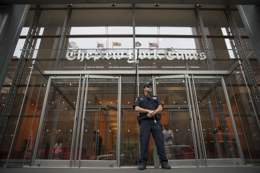 In this June 28, 2018, file photo, a police officer stands guard outside The New York Times building in New York. (AP Photo/Mary Altaffer, File)